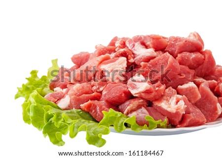 Fresh raw meat and salad isolated on white - stock photo