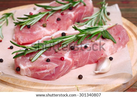fresh raw meat with rosemary and pepper - stock photo