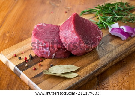 Fresh raw meat with spices close-up. Sliced Beef - stock photo