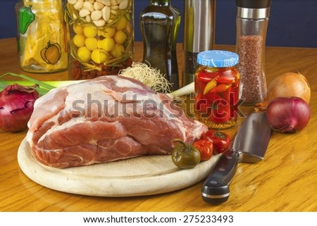 Fresh raw pork on a cutting board with vegetables and spices, preparation of meat for grilling - stock photo