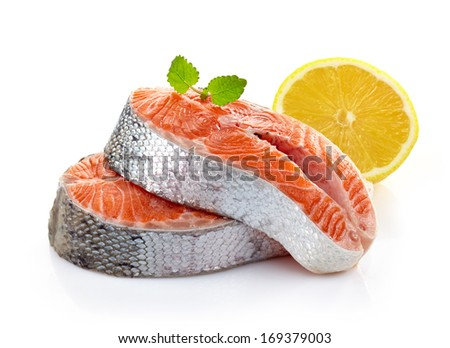 fresh raw salmon steak slices on a white background - stock photo