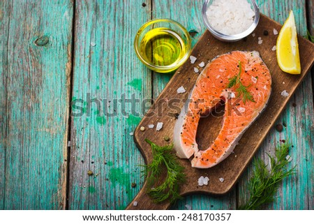 fresh raw salmon steak with herbs and spices - stock photo