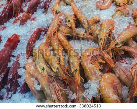 Fresh raw shrimps in the market. Seafood - stock photo
