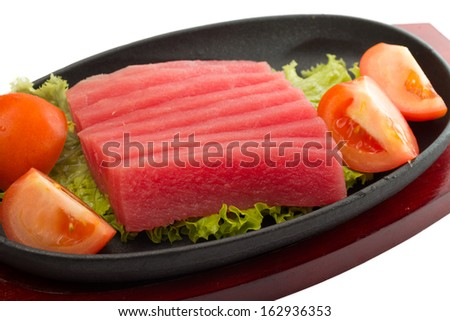 fresh raw tuna fish pieces on plate isolated - stock photo