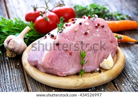 Fresh raw turkey meat on wooden background - stock photo