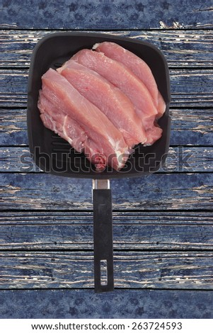 fresh raw turkey meat steak fillet over blue wooden table ready to cooking - stock photo