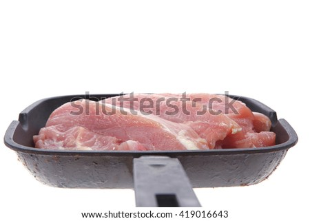 fresh raw turkey pieces on black pan isolated over white background - stock photo
