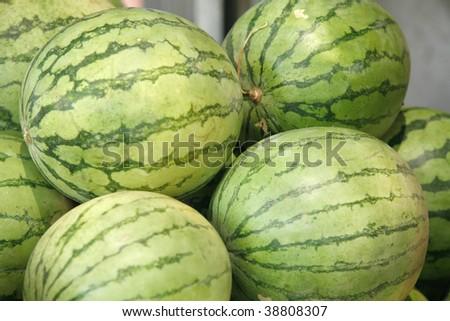 fresh raw watermelon heap on open market - stock photo