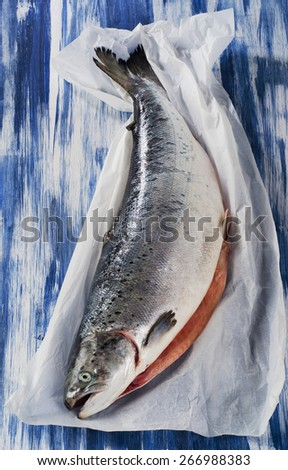 Fresh raw whole Salmon . Healthy food. Top view - stock photo