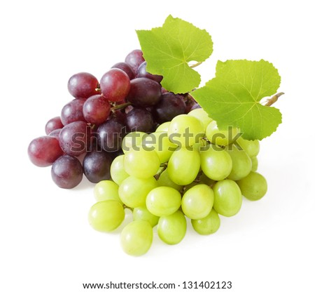 Fresh red and green grapes with leaves. Isolated on white - stock photo