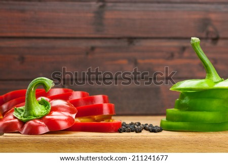 Fresh red and green peppers sliced into the rings - stock photo