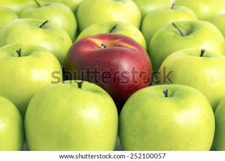 Fresh Red Apple Between Green Apples - stock photo