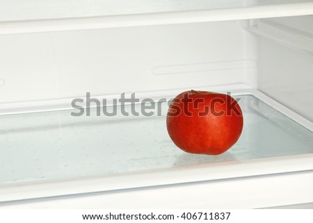 Fresh red apple in domestic refrigerator. - stock photo