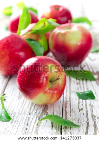 Fresh red apples on wooden background - stock photo