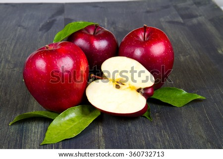 fresh red apples with leaves - stock photo