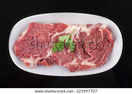 Fresh Red Beef Ribs with Dill and Green Sprouts - stock photo