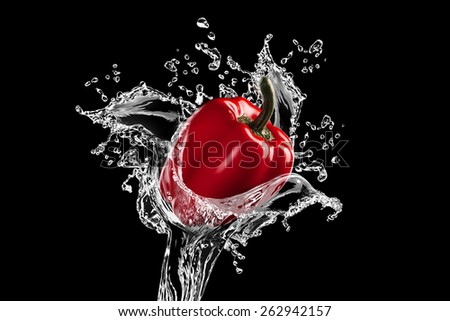 Fresh red bell pepper gets hit by a water stream on black background. Water splashes concept - stock photo