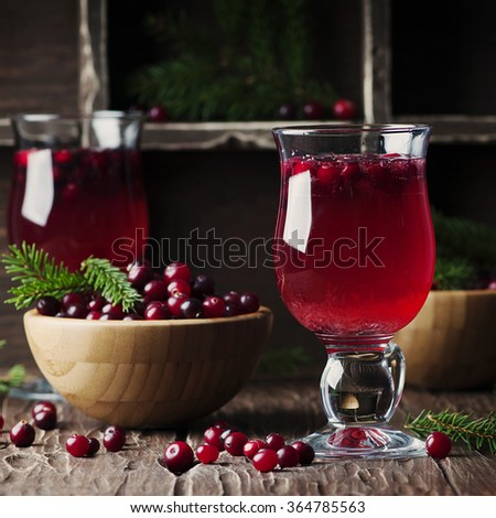 Fresh red cranberry juice on the vintage table, selective table and square image - stock photo