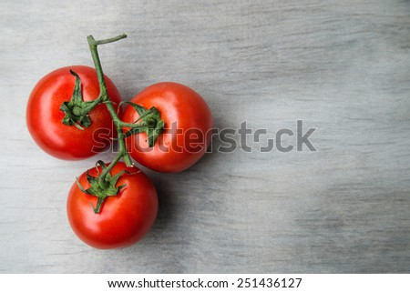 fresh red delicious cherry tomatoes on an  old wooden tabletop. Selective focus, close up.  - stock photo