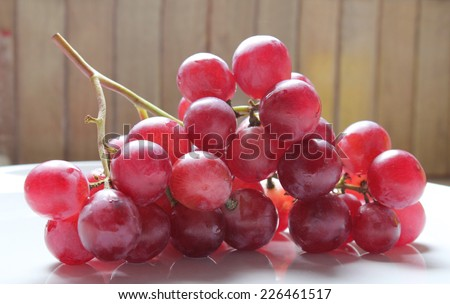 Fresh red grapes and water drops isolated on white background,  Bunch of red grapes - stock photo