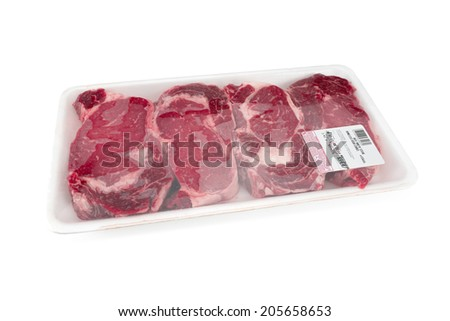 Fresh red meat packed in a poly bag. - stock photo