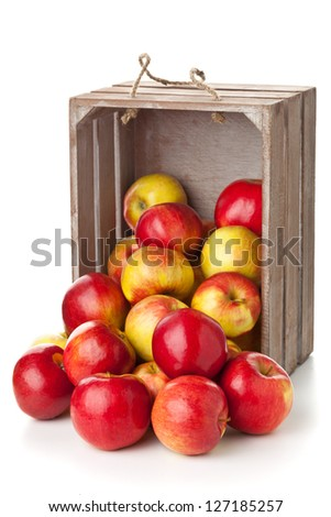 Fresh red organic apples in wooden crate on white background - stock photo