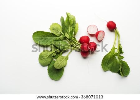 Fresh red radish isolated on a white background close up. - stock photo