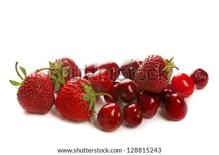Fresh red ripe strawberries and cherries isolated on white - stock photo