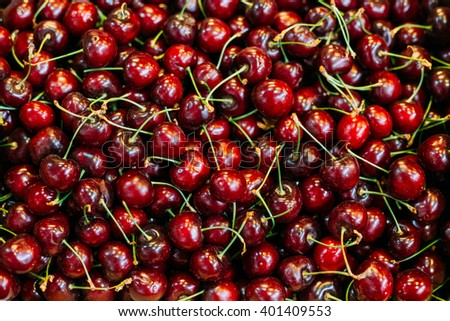 Fresh red ripe sweet cherry berries forming background on farmers market - stock photo