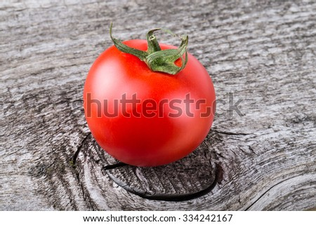 Fresh, red, ripe tomatoes on old grey wood background. - stock photo