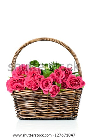 Fresh red roses in the wicker on white background - stock photo