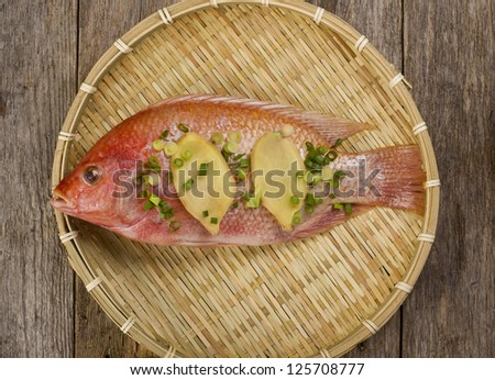 Fresh Red Snapper With Ginger and onions. - stock photo