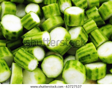 Fresh ridge gourd raw Luffa Squash or Touria used in asian cooking or dried out to scrub your back. - stock photo