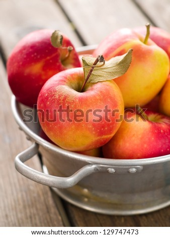 Fresh ripe apples in bowl, selective focus - stock photo