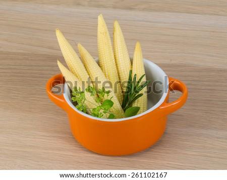 Fresh ripe Baby corn on the wood background - stock photo