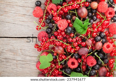 Fresh ripe berries on wooden table background with copy space - stock photo