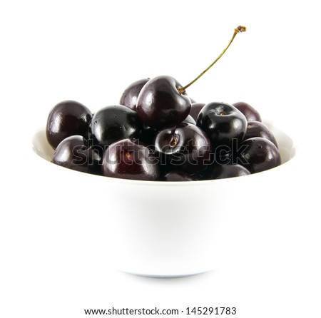 Fresh ripe black cherries in a white bowl. Isolated on a white background - stock photo