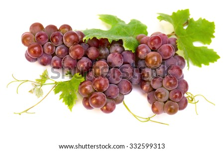Fresh ripe grapes(Vitis vinifera) with leaves on white background - stock photo