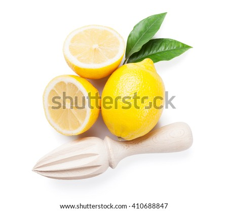 Fresh ripe lemons and juicer. Isolated on white background. Top view - stock photo