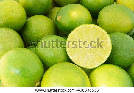 Fresh ripe limes as background, lime citrus fruit close up - stock photo