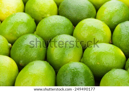 Fresh ripe limes on wooden table - stock photo