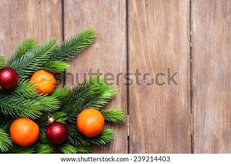 Fresh ripe mandarins  and fir tree bud on wooden background - stock photo