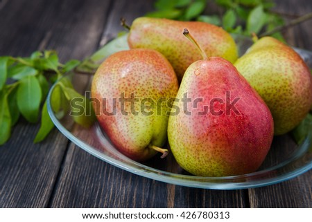 fresh ripe organic pears on a rustic wooden table - stock photo