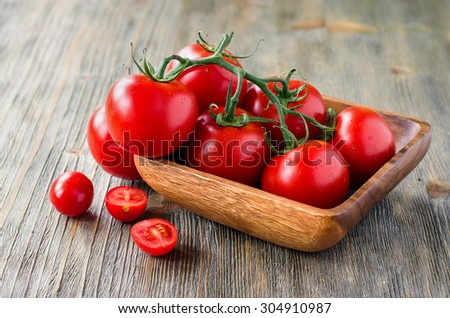 Fresh ripe organic tomatoes, vegetables ingredients, healthy cooking and eating - stock photo