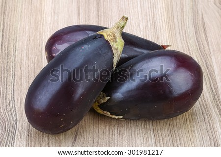 Fresh Ripe Raw eggplants on the wood background - stock photo