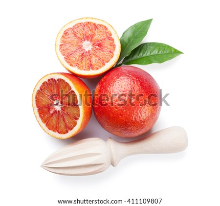 Fresh ripe red oranges and juicer. Isolated on white background. Top view - stock photo