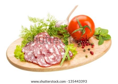 Fresh ripe salami with vegetables - stock photo
