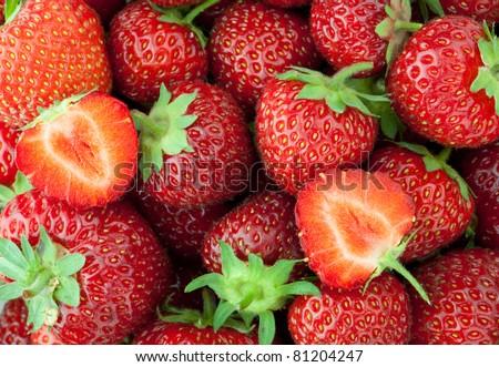 Fresh ripe strawberry closeup and two halves - stock photo