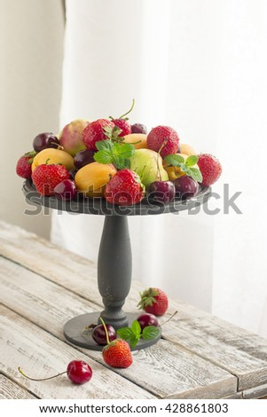 Fresh Ripe Sweet Fruits on the Wooden stand . Fresh Organic Food. Fresh Berries - stock photo