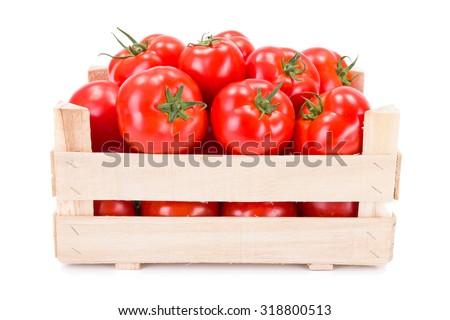 Fresh ripe tomatoes (Solanum lycopersicum) in wooden crate - stock photo